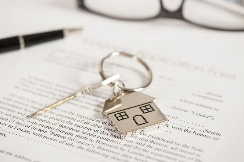 homeowners insurance paperwork and house key, home insurance terms