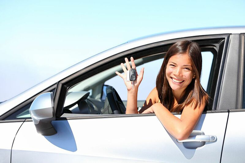 teen drive leaning out of car window, auto insurance through your parents
